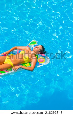 Young woman in bikini in the swimming pool - stock photo