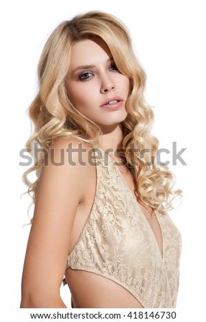 Young woman in bikini posing on white background in bikini - stock photo