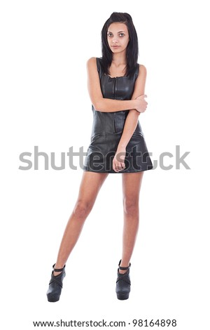 young woman in black leather, studio shot - stock photo