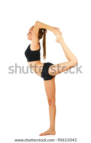 Young woman in black practicing yoga isolated on white background - stock photo