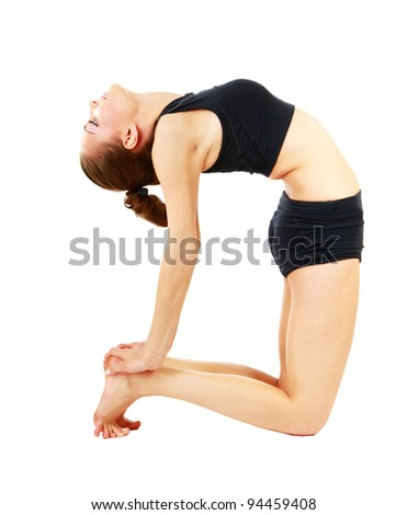 Young woman in black practicing yoga isolated on white background