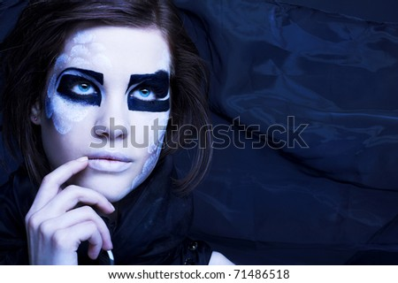 Young woman in black scarf with original  creative make-up - stock photo