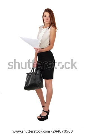 Young woman in black skirt and white shirt holding bag and  lists of paper isolated over white background - stock photo