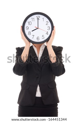 young woman in black suit holding office clock isolated on white background