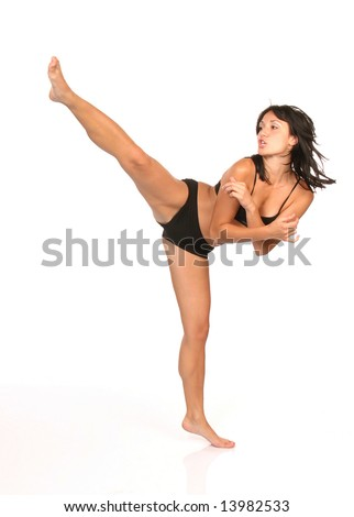 Young woman in black underwear kicking, on white background, clipping path included