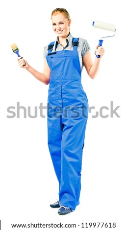 Young woman in blue overalls with painting tools , isolated on white - stock photo