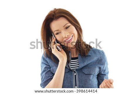 Young woman in blue shirt talk over her mobile phone - stock photo