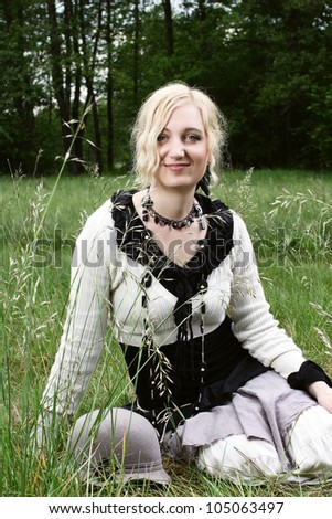 young woman in boho style on the grass
