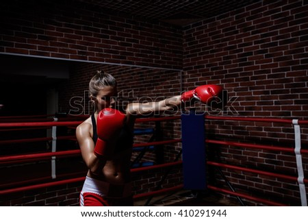 Young woman in boxing ring