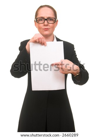 Young woman in business suit and glasses pointing to the sheet of paper with her finger isolated on white with copyspace - stock photo