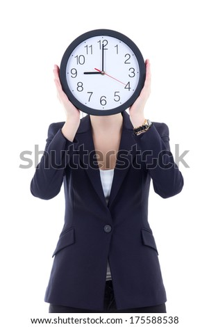 young woman in business suit holding office clock isolated on white background