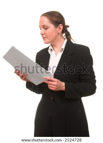 Young woman in business suit looking through the documents - stock photo
