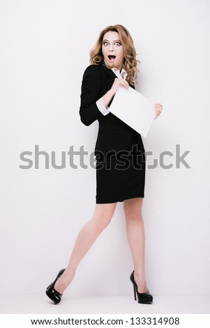 Young woman in  business suit with blank paper - stock photo