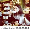 young woman in cafe - stock photo