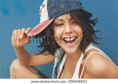 Young woman in cap. Lifestyle portrait