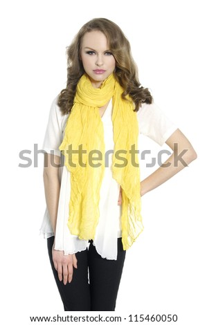 young woman in casual clothes with yellow scarf posing