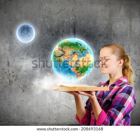 Young woman in casual hiding face behind reading. Elements of this image are furnished by NASA