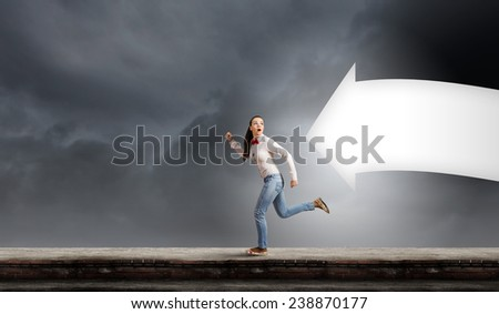 Young woman in casual running in a hurry