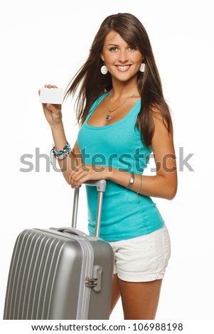 Young woman in casual standing with silver travel bag holding empty credit card, isolated on white background