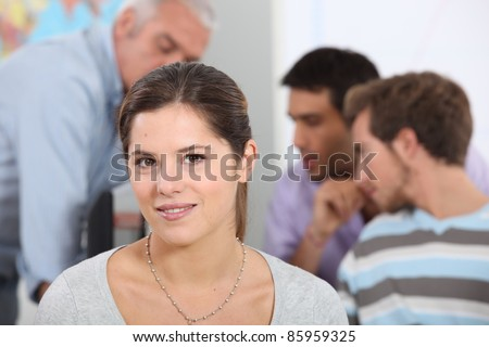 Young woman in classroom - stock photo