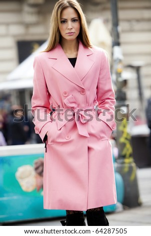 young woman in coat, street shot - stock photo