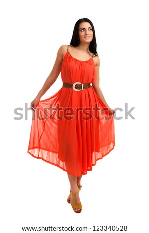 Young woman in coral dress - stock photo