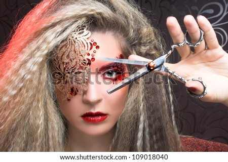 Young woman in creative image and with scissors - stock photo