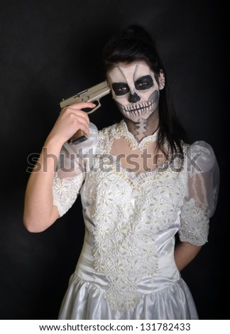 Young woman in day of the dead mask skull face art. Halloween face art.