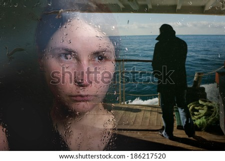 young woman in depression near the window - stock photo