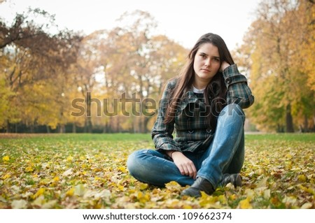Young woman in depression outdoor - stock photo