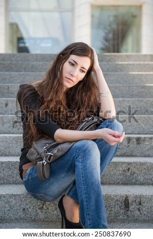 Young woman in depression  - outdoor portrait, negative expression - stock photo