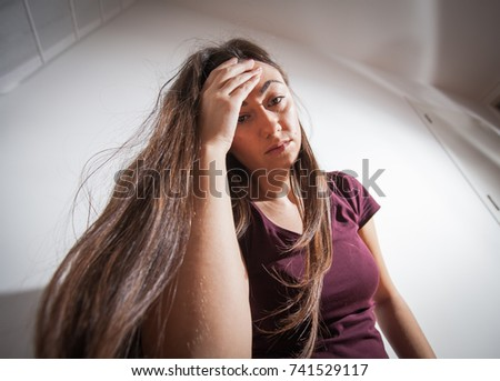 Young woman in depression , sad depressed female.
