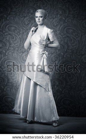 Young woman in dress. Black and white contrast colors. - stock photo
