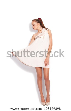 young woman in elegant dress full body shot studio white - stock photo