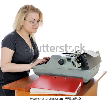 Young woman in eyeglasses with old typewriter. - stock photo
