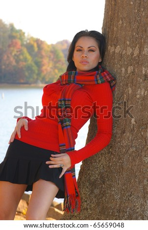young woman in fashionable attire in outdoor setting