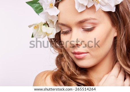 Young woman in floral wreath - stock photo