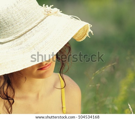 young woman in flowery field on a summer day