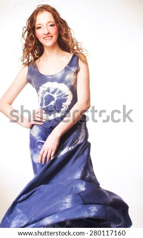 Young woman in flutter blue dress - stock photo
