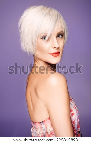 Young woman in front of a purple background  - stock photo