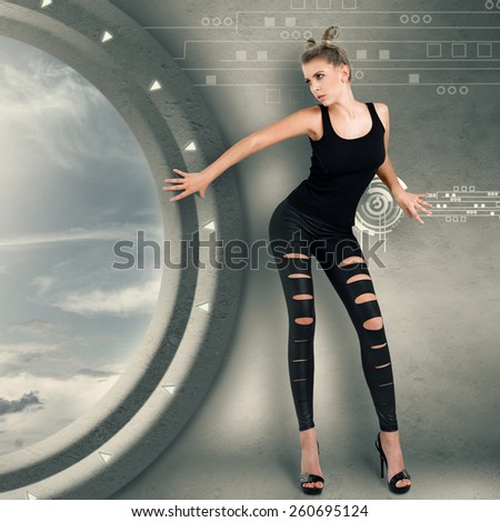 Young woman in futuristic interior playing science fiction crime scene - stock photo