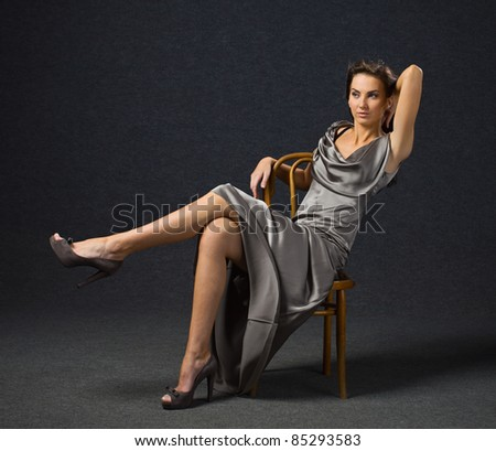 young woman in grey evening dress, professional make-up. - stock photo