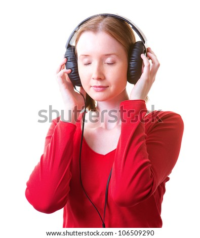 Young woman in headphones with eyes closed, listening to something, isolated on white - stock photo
