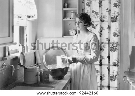 Young woman in her kitchen, baking - stock photo