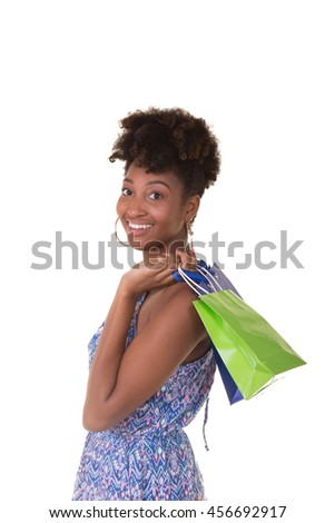 Young woman in her twenties carrying shopping bags