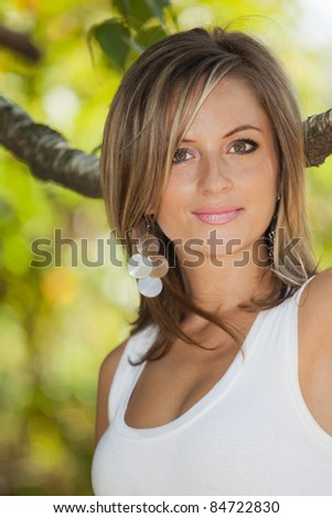 Young woman in her twenties, in the park in summer. - stock photo