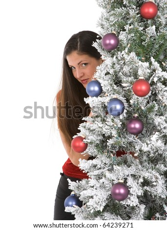 Young woman in her twenties with holiday christmas tree - stock photo