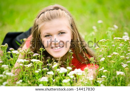 Young woman in high green grass. - stock photo