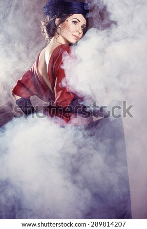 Young woman in in the fog at retro style