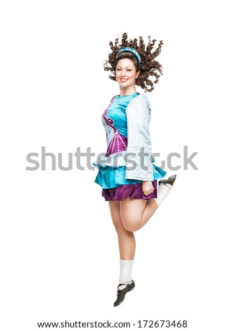 Young woman in irish dance dress and wig dancing